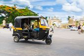 Auto Rickshaw in front of Mysore Palace.