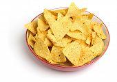 Bowl of nacho corn chips on white background