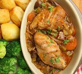 Chicken casserole served with roast potatoes and broccoli