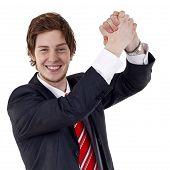 image of woohoo  - One very happy energetic businessman with his arms raised - JPG