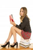 School Girl Sit On Stack Of Books Reading