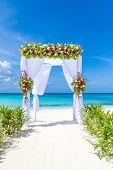 wedding arch and set up on beach, tropical outdoor wedding cabana on beach