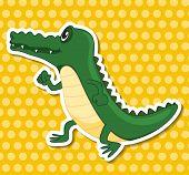 A crocodile sticker on yellow