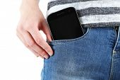 Smart phone in pocket jeans close-up