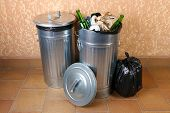 Recycling bins on wall background