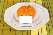 Autumn Thanksgiving Dinner Table Setting With Decorative Pumpkin.
