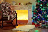 Beautiful Christmas interior with fireplace and fir tree