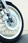 Motorcycle forks and tire, close-up