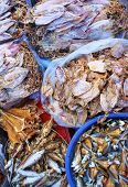 stock photo of squid  - Dried shredded squid seafood product made from squid or cuttlefish commonly found in coastal Asian show at Vietnam open air market is popular street snack - JPG