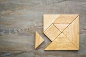 pic of wood pieces  - a missing piece in a square built from tangram pieces - JPG