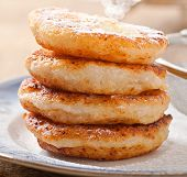 Cottage cheese pancakes sprinkled with powdered sugar