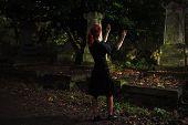 Redhead Woman Performing Ritual At Grave