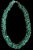Necklace with Green Gemstones and Gold, Isolated on Black Background