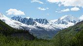 stock photo of wilder  - Mountains rise above green valleys in Alaska - JPG