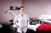 picture of beauty salon interior  - Female beautician in her new modern beauty and massage salon - JPG