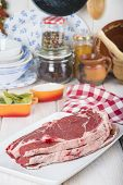 picture of porterhouse steak  - Raw steaks on the kitchen table ready to cook - JPG