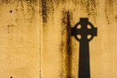 picture of celtic  - grunge wall background texture with celtic cross shadow - JPG