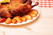 pic of roast duck  - Roast duck with apples and oranges on kitchen tablecloth - JPG