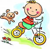 pic of tricycle  - Little boy riding his tricycle - JPG