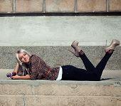 foto of slender legs  - Fashion photo of beautiful slender girl model in leopard print jacket with sunglasses - JPG