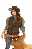 picture of pistols  - a cowgirl with a serious expression on her face holding on to her saddle - JPG