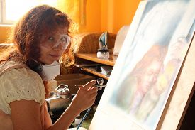 image of airbrush  - A young woman painting with airbrush equipment and airbrush gun - JPG