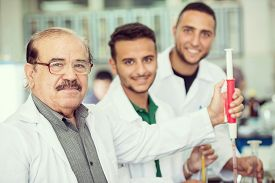 pic of conduction  - Group of scientists conducting research in a lab environment - JPG