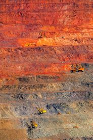 stock photo of iron ore  - iron ore open pit mining quarry red brown - JPG