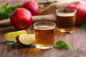 image of fruit-juice  - Glasses of apple juice and fruits on table close up - JPG