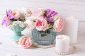 picture of violets  - Pink roses white jasmine and violet clematis flowers and candles on white wooden background - JPG
