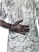 stock photo of doughy  - Dirty hand towards a dirty white t - JPG