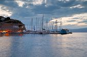 stock photo of hydra  - Boats mooring at a pier in harbour of Hydra - JPG