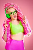 image of dreadlock  - Trendy DJ party girl in bright clothes - JPG
