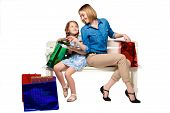 foto of wonderful  - Happy mother and daughter with shopping bags sitting at studio - JPG