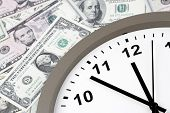 picture of american money  - Clock on assorted American banknotes - JPG