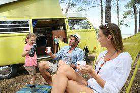 picture of camper  - happy family relaxing by camper van in summer - JPG