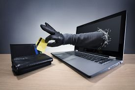 picture of network  - Stealing a credit card through a laptop concept for computer hacker - JPG