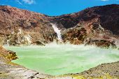 Hot acid lake in volcanic crater, White Island volcano, New Zealand