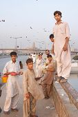 KARACHI, PAKISTAN - NOV 14: Boys on the Netty Jetty Bridge sell offal for kite feeding on November 1