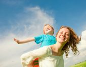 stock photo of summer fun  - Mother and Son Having Fun - JPG