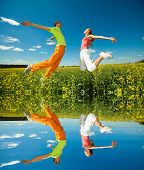 Young love Couple smiling under blue sky. Specular reflection in the water.