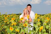 Happy people in sunflowers