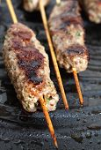 Lamb Kofta On A Grill Plate Vertical