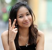 pretty young smiling asian woman on the street