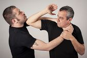 Постер, плакат: Street Fighting Self Defense Technique Against Holds And Grabs