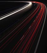Cars in a rush moving fast on a highway in the UK (speedway) at dusk