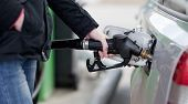 foto of fuel pump  - Car fueling at the gas station - JPG