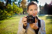 pretty female photographer outdoors