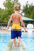 Young boy on a diving board