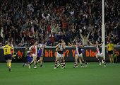 MELBOURNE - SEPTEMBER 18: Saint Kilda players cellebrate skipper Nick Riewoldt's match winning goal
